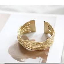 Pynės formos, aukso spalvos apyrankė